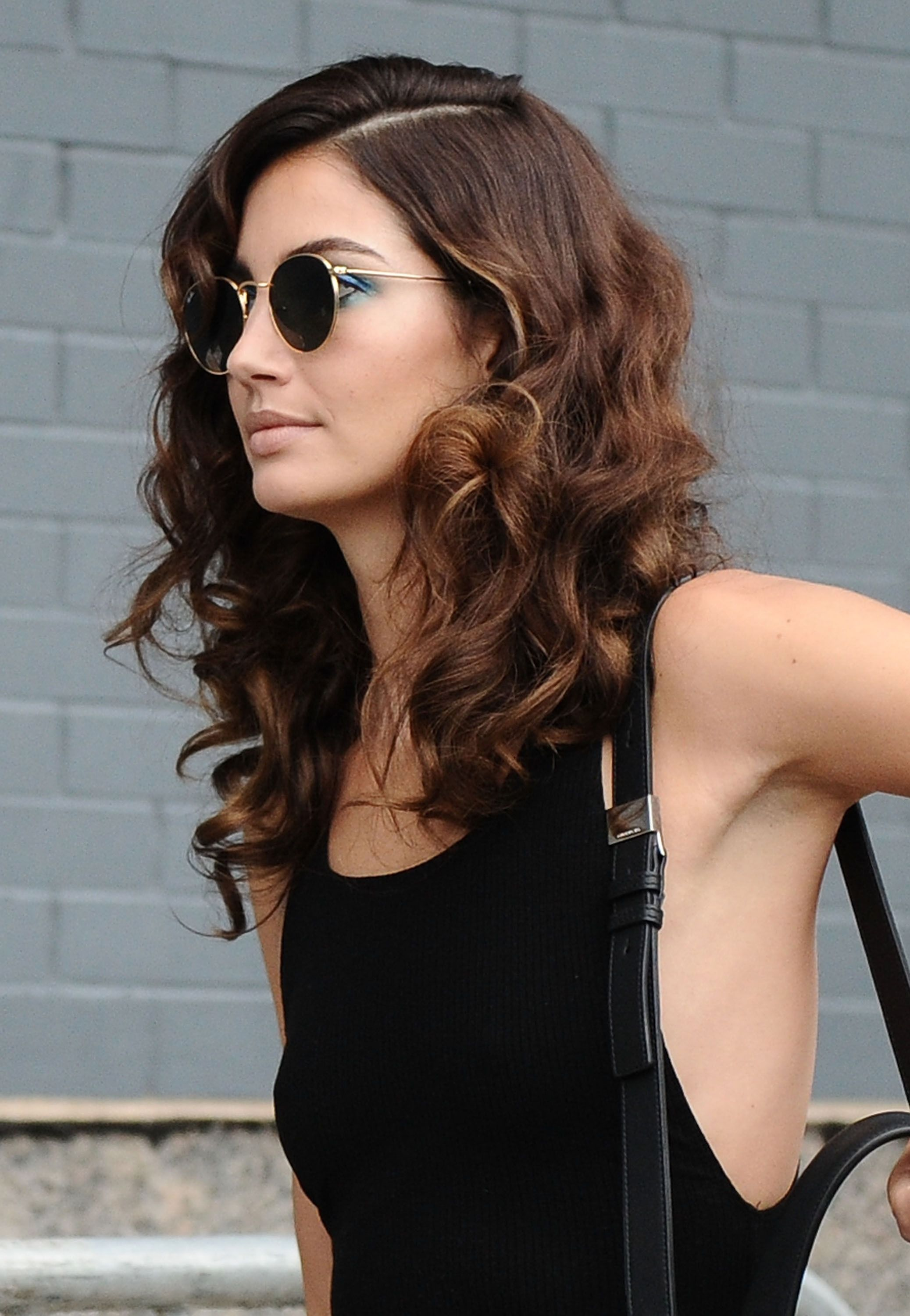 mediumlength hairstyles to steal from celebrities tight curls