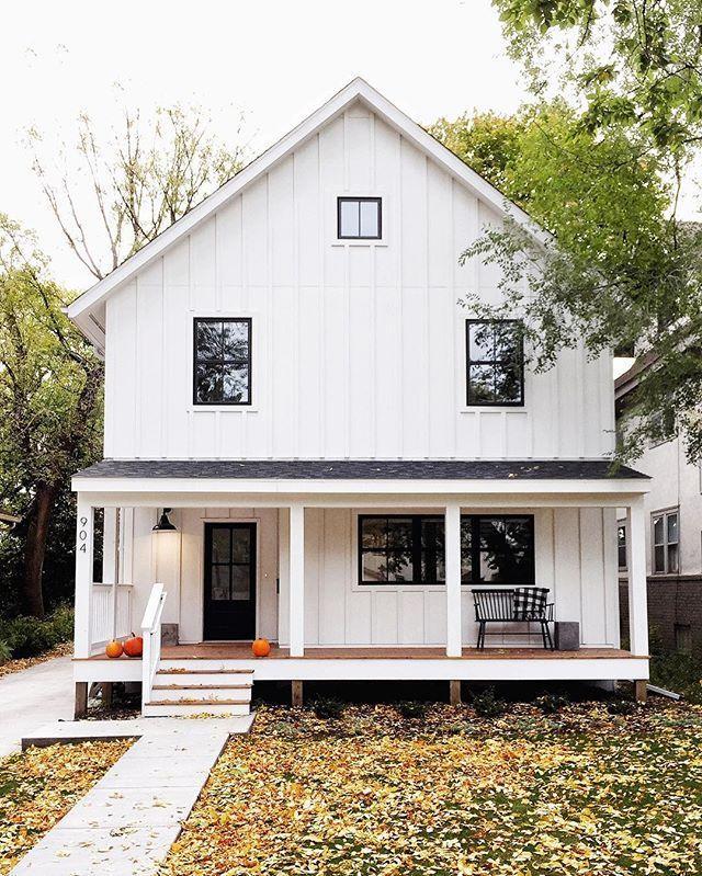 White Board And Batten Vinyl Vertical Siding Black Framed Windows Wood Deck Metal Roof Modern Farmhouse Exterior Farmhouse Exterior House Exterior