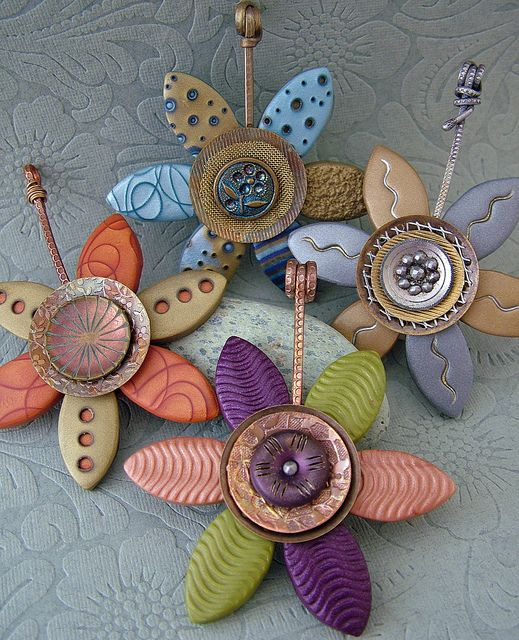 Vintage Button Flower Pendants by Julie Picarello.  Some PMCs, and some plain poly clay. Love the mix,  love her work.