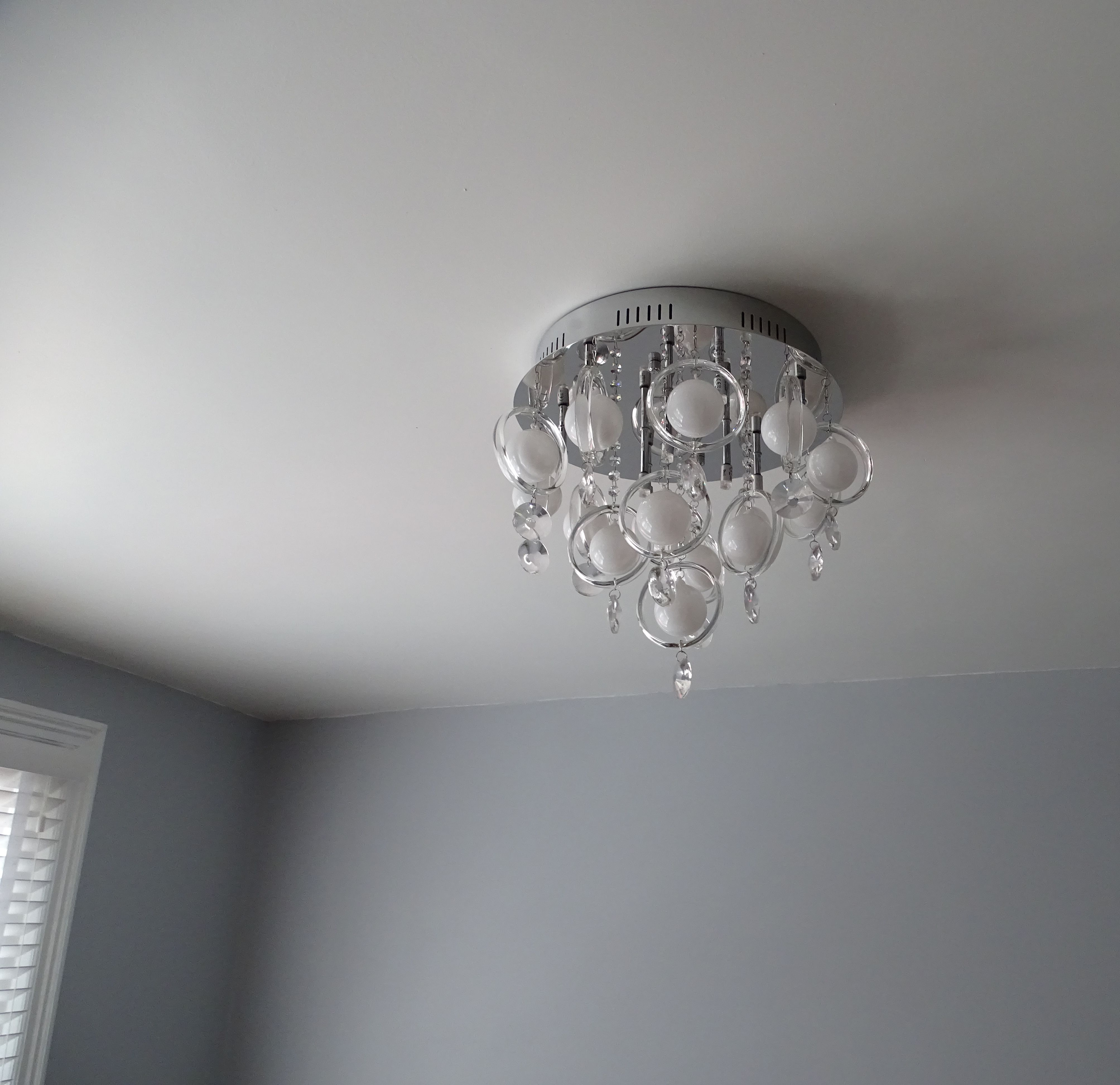 Grey Lounge With Modern Glass Chandelier Bottlefly Wings Paint By Valspar Interior Paint Modern Glass Chandeliers Lowes Interior Paint
