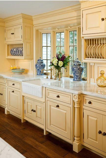 Like: Pretty much everything except the color of the cabinets. They are too yellow for my liking. If they were creamy white glazed I would like them a lot more. Like the banisters, plate holders, moulding, and flooring.