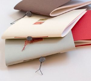 Single signature pamphlet stitch binding with linen thread and seal closure