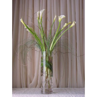 Charmant Calla Lily With Bear Grass And Curly Willow In A Cylinder Glass Vase.