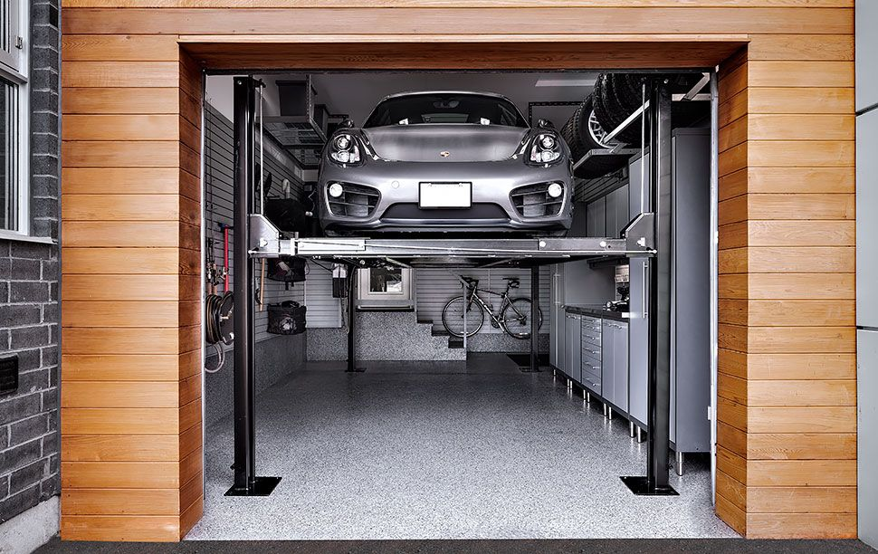 Silver Porsche On A Car Lift In The Lower Position Garage Car Lift Car Garage Garage Makeover