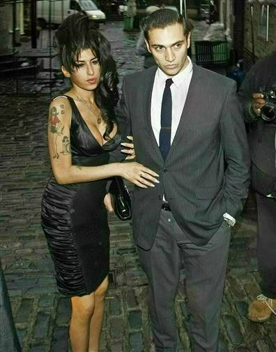 Amy Winehouse and Reg Traviss pictured in Camden Town, London, on Aug. 5, 2010.