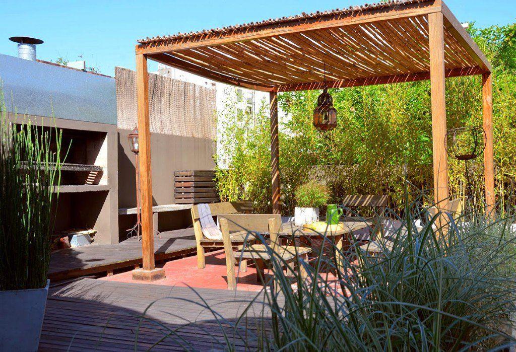 Ideas para decorar la azotea de tus sue os interiors en - Sombrilla de terraza ...