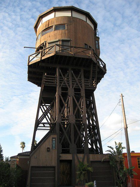 This fine example of a water tower was built in the 19th century to provide to provide water for steam engines. It operated all the way until 1974, and in the 80s it was converted to a home by removing the tank, converting it at ground level and then lifting it back up into place. It has served as a family home at times since then, but mostly it has been an opulent vacation rental. Visitors travel up four stories on the elevator to reach the three-story living space, then get to enjoy…