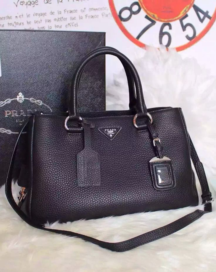 140d3afe7ae102 ... order prada soft leather tote bag is made of genuine soft leather with  gracious textile lining