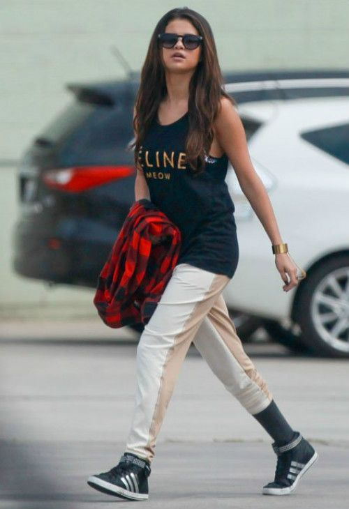 Selena Gomez wearing Adidas Neo Daily Twist Mid-Top Sneaker Nissa Jewelry Chained Cuff Wellicious Two Tone Pants