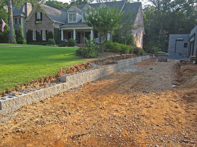low concrete retaining wall along driveway Driveways