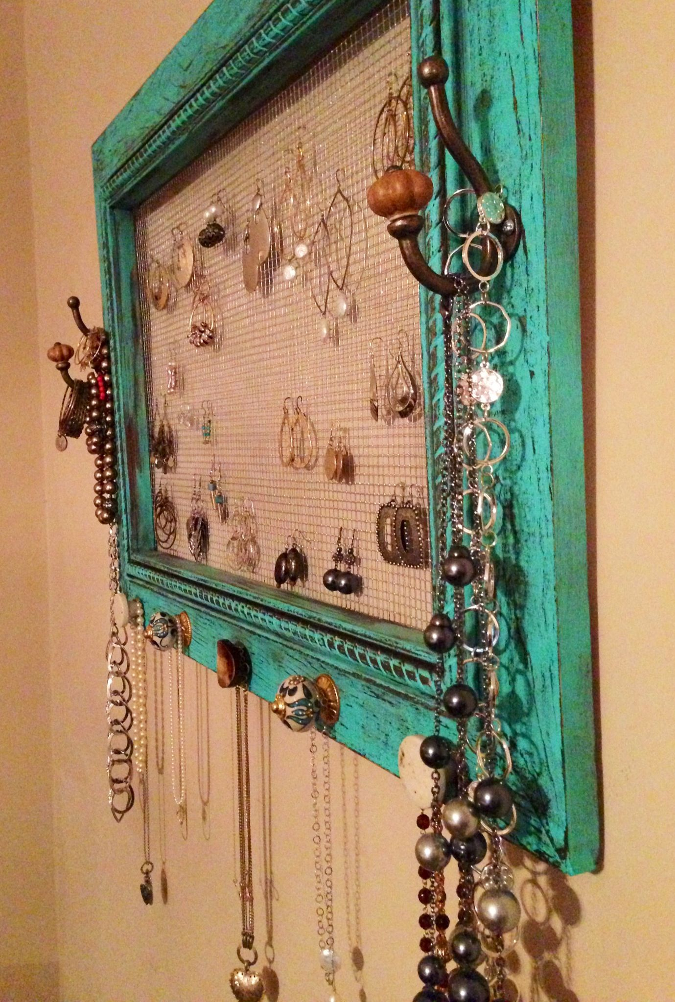 Jewelry organizer made with picture frame and chicken wire jewelry
