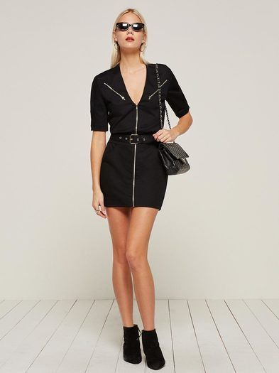 The 80's called - they want their mini back. This is a mini length dress with a center front exposed zipper and belt. http://bit.ly/2k7axfj
