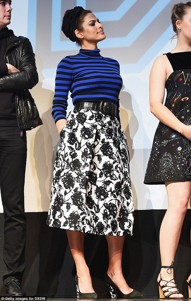 Hot mama:Eva looked  stylish in a Michael Kors top and skirt