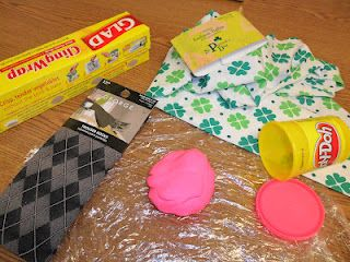 """OT Tools for Public Schools: Homemade Fidget Toy.  Wrap Play Doh in plastic wrap and put it in a sock (according to the author - a """"tacky"""" sock)  I love it - have lots of tacky """"teacher socks""""."""