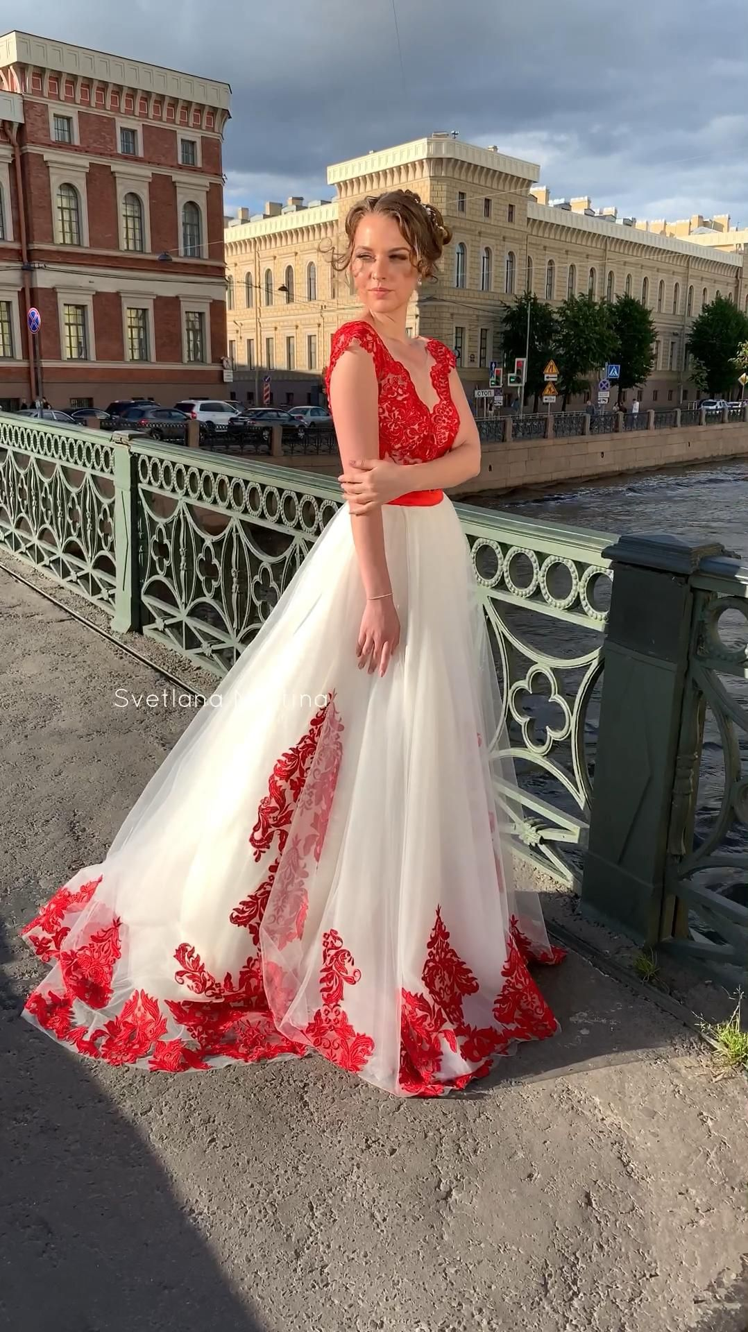 Red wedding dress with a slit on the leg by Svetla