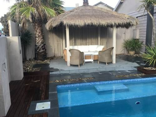 Beach Haven Poolside Bonbeach Boasting sea views, Beach Haven Poolside is a 3-bedroom holiday home located less than 100 metres from Bonbeach. Guests can enjoy the beautiful private solar-heated pool, and a patio. Free parking and free WiFi are provided.