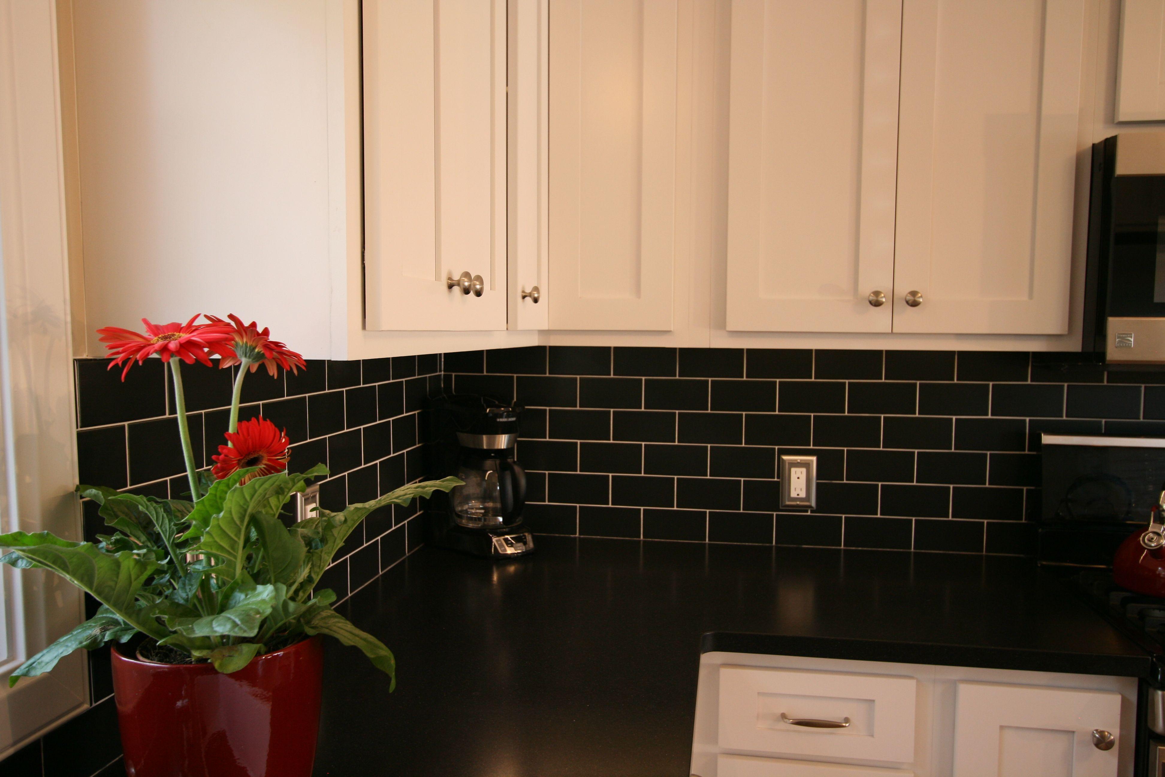 White cabinets black subway tile & black granite countertops