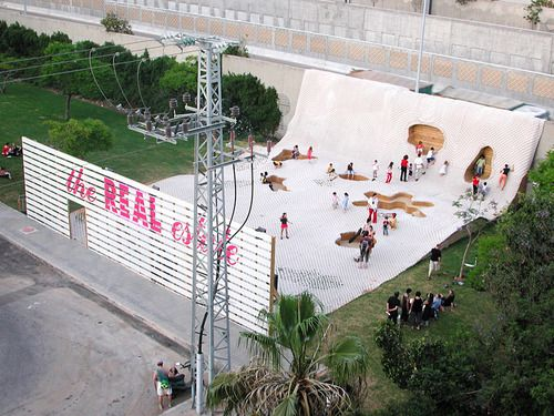 """the Real estate: an israeli public space installation that transformed a forgotten, underutilized edge along a major highway into a gathering space. The project's name is intended to suggest """"that the real assets of dense urban cities are outdoor public space."""""""