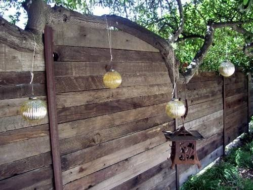 For the hot tub area, build a reclaimed wood fence with horizontal panels. A