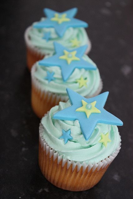 Cupcakes decorated with blue and yellow fondant stars