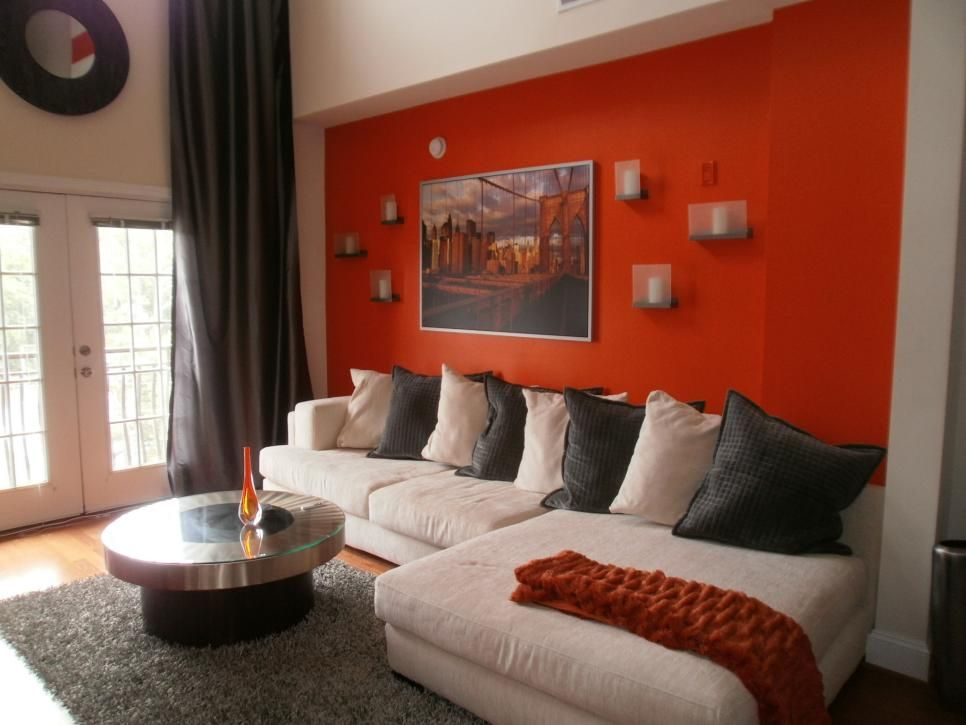 Contemporary Living Room With Orange Accent Wall And Cream Colored