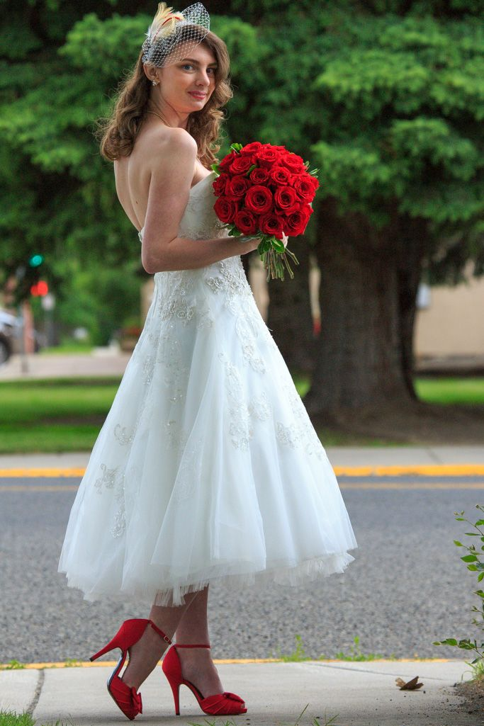 Tea length wedding dress with birdcage veil and red shoes | Tea ...