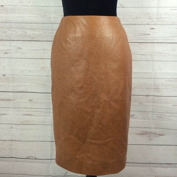 "Michael Kors pencil leather skirt Michael Kors leather skirt Sz 4  long 24"" it have a small tear where the back opening start the little tear has been fixed see last pic hardly noticeable NO HOLDS, NO TRADES KORS Michael Kors Skirts Pencil"