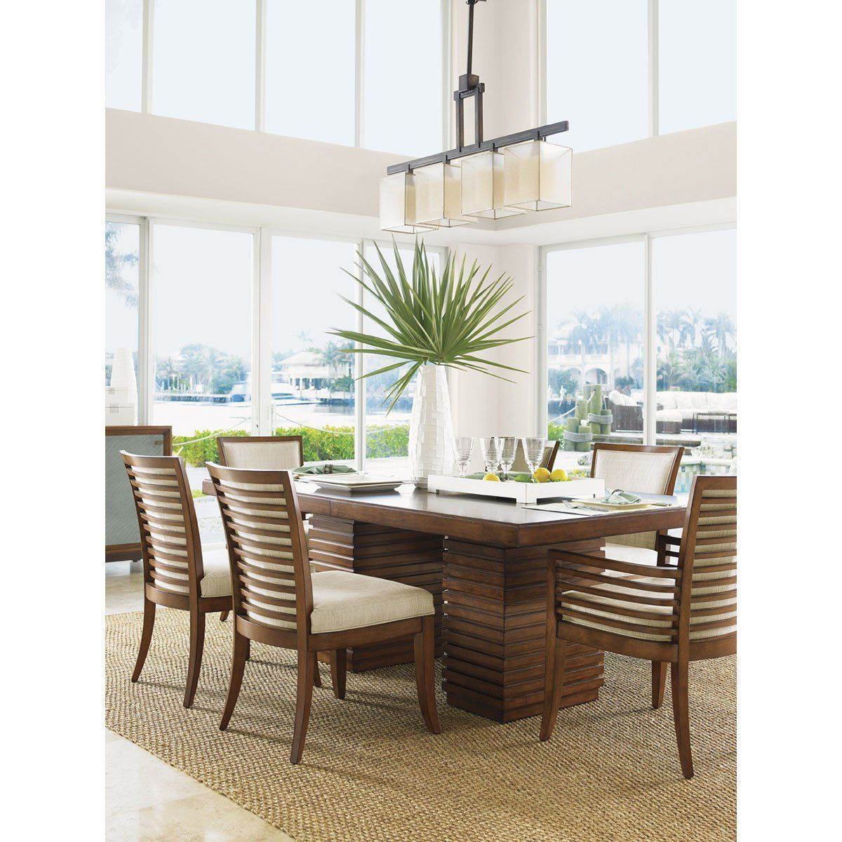 From Tommy Bahama Ocean Club Collection This Stunning Peninsula Dining Table Boasts A Modern Silhouette Made Up Of Clean Crisp Lines