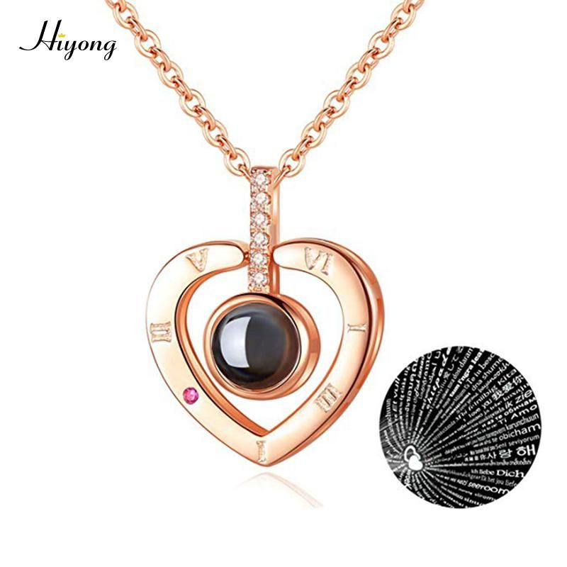 Brand Name: HIYONGMetals Type: Copper AlloyMetals Type: CopperNecklace Type: Pendant NecklacesGender: WomenFunction: AdornmentChain Type: Link ChainItem Type: NecklacesPendant Size: 17*17cmCompatibility: All CompatibleFine or Fashion: FashionModel Number: NH001Style: TRENDYMaterial: Metalis_customized: NoShape\pattern: HeartHigh Quality: AAA CZ diamond PaveCtystal: AAA Clear Cubic ZirconFeature: 100 Languages, I Love YouColor: Rose Gold,SilverStyle: Fashion CZ Projection pendant necklaceFactory: