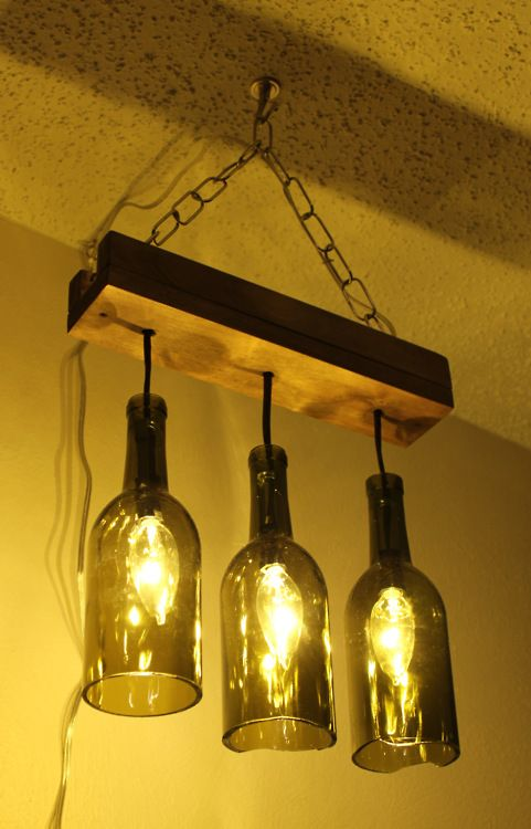 diy wine bottle chandelier--cute...I would make it look a little nicer than that but the concept is neat!