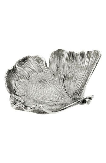 A cast-metal serving dish is forged with the delicate details of a ginkgo leaf.