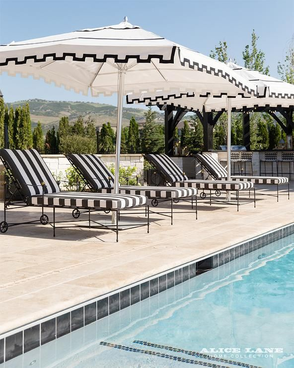 Patio Features A Row Of Black And White Striped Pool Loungers Accented With  Black And White