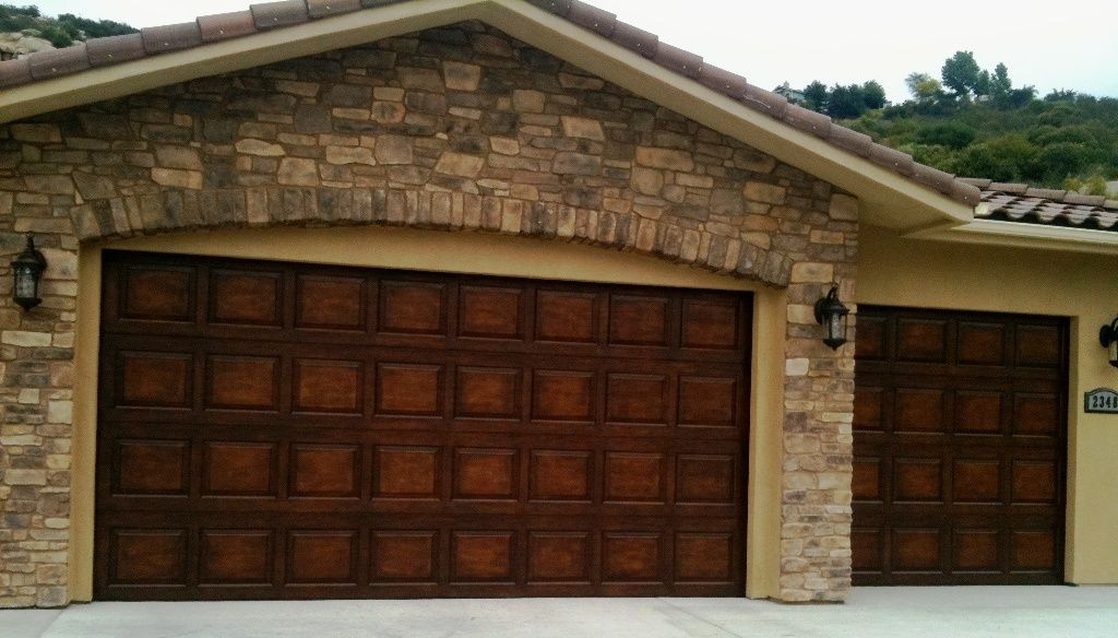 plain jane steel builder grade garage doors stained to