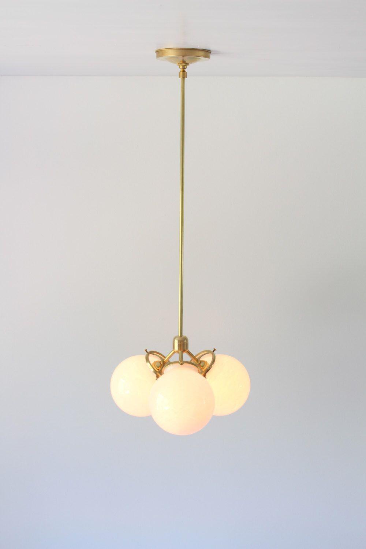 modern industrial pendant lighting. Modern Brass Chandelier, 3 White Glass Globes, Industrial Pendant Lighting And Home Decor By