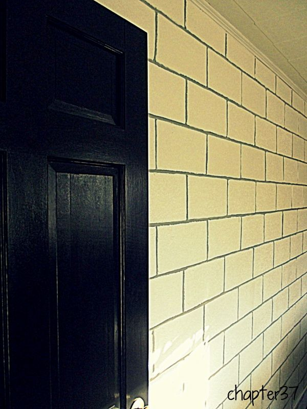 painted cinder block wall white with grey grout. found via blog ...