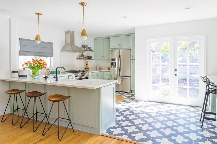Contemporary Kitchen Features Mint Green Cabinets Adorned