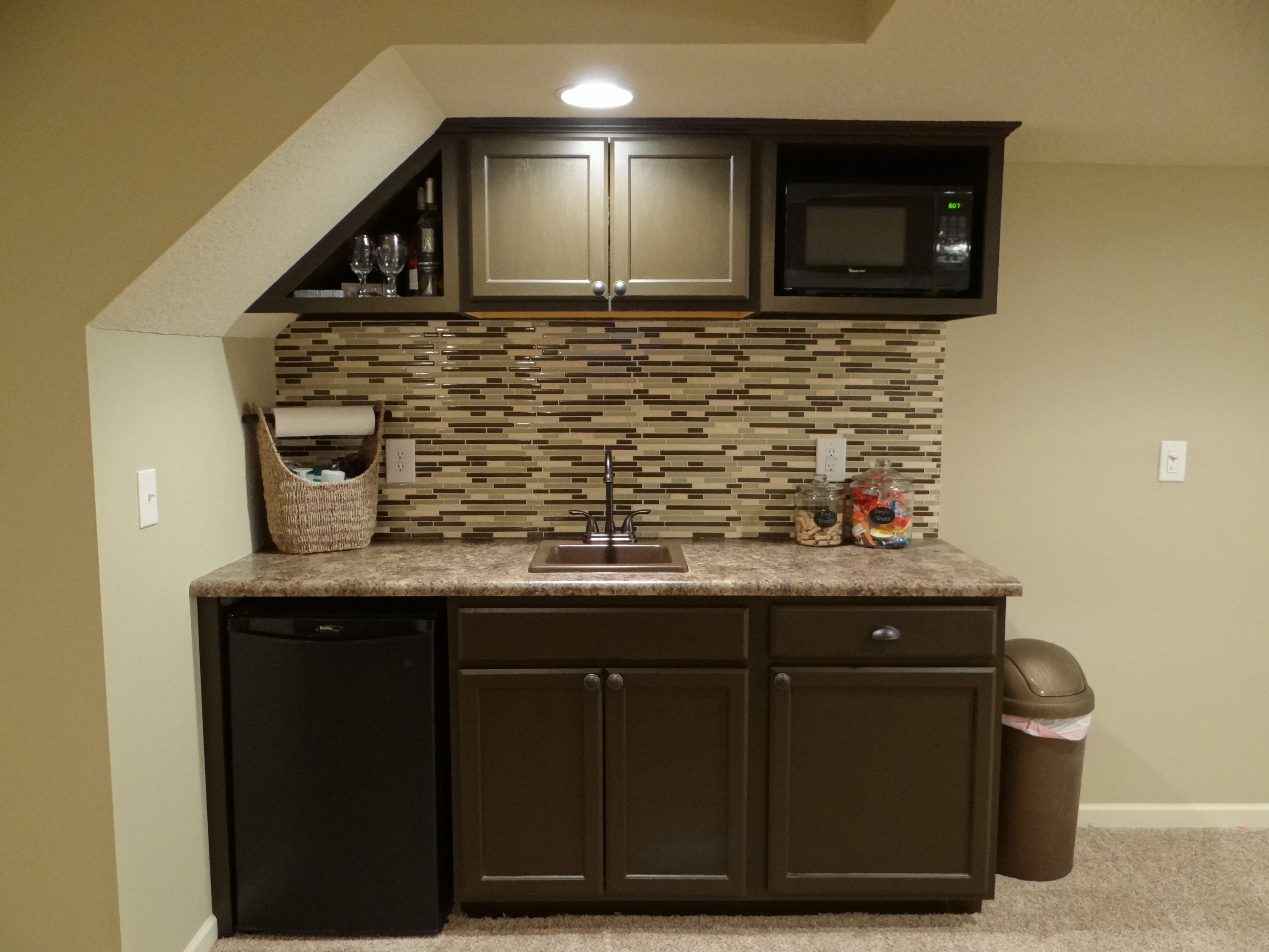 Basement wet bar under stairs used cabinets white  house