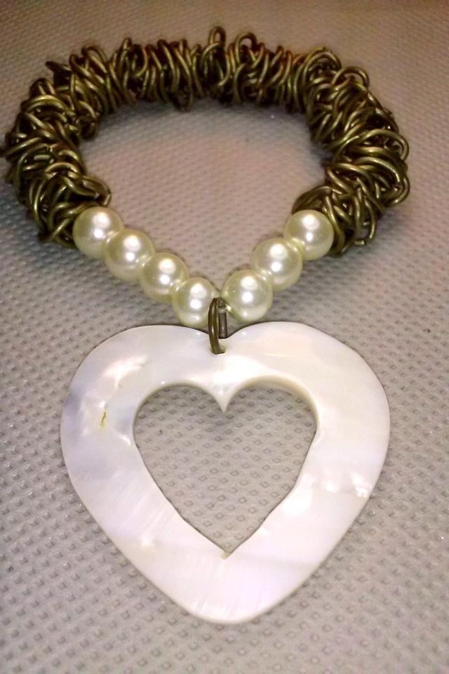 oro viejo y corazon de concha, y perlas