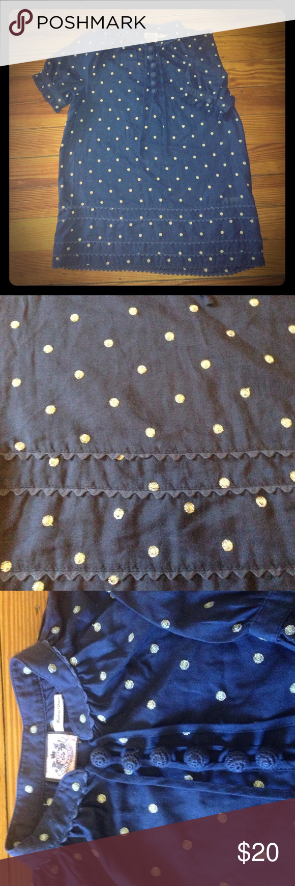 Juicy couture Navy blouse size 2 Juicy couture Navy blouse size 2. Navy with gold and light blue embroidered polka dots. Fun round crocheted buttons on the top and the sleeves. Also has two strings that can tie at the collar. Fun ruffle like embellishments at the bottom, on the sleeves and collar. This is a fun shirt with lots of unique details. Juicy Couture Tops Blouses