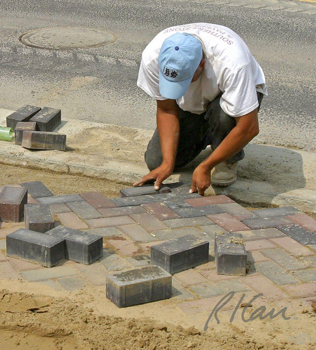 pavement construction placing brick pavers in herringbone pattern
