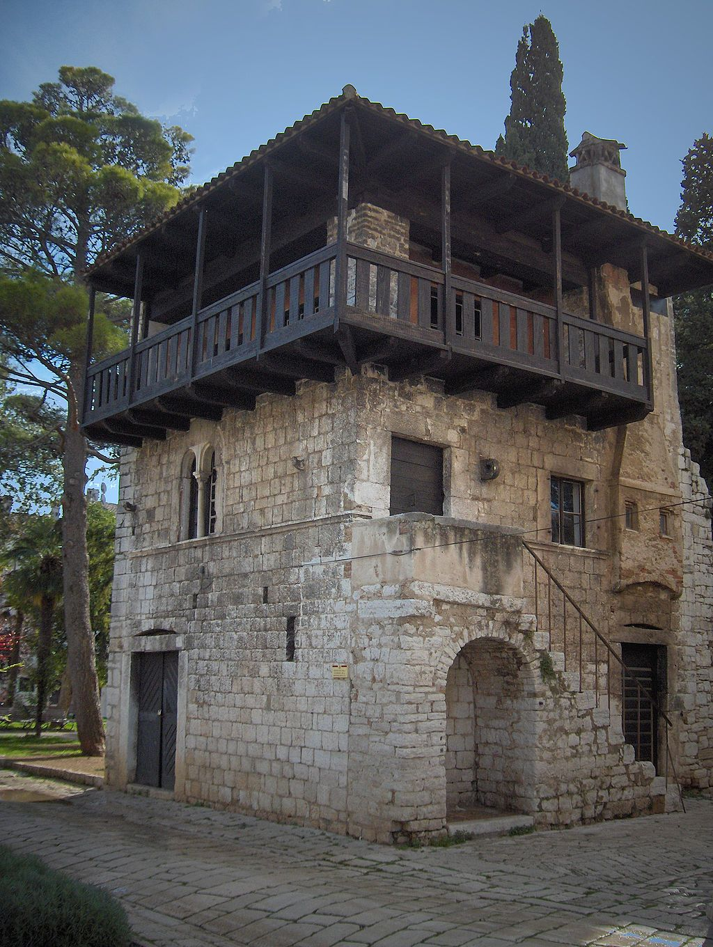 A Small Three Storey Stone House With An Exterior Stone