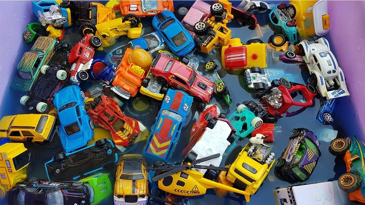 Car Toys For Kids Playing Toy Cars Throw Into Blue Water