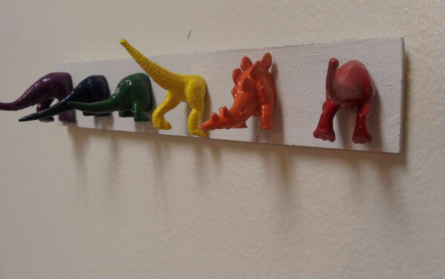 Dinosaur Butts Towel Holder But With A Neutral Color