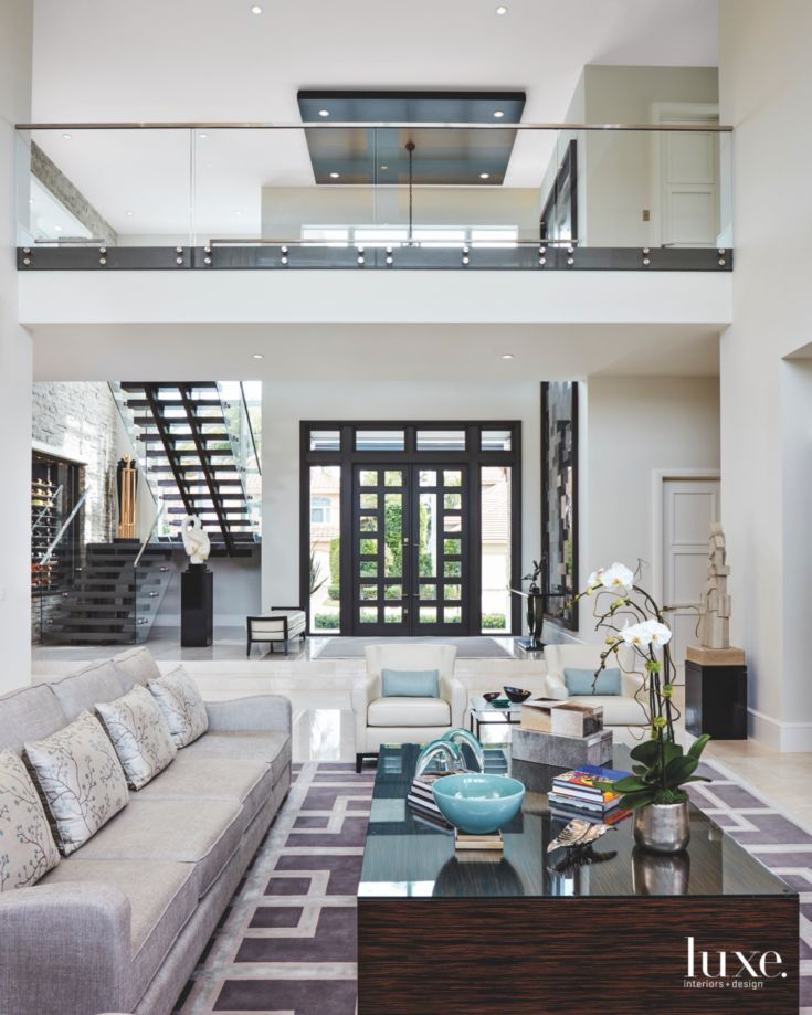 Double Height Living Room With Interior Bridge Glass Windows And Brown Color Scheme High Ceiling Living Room Living Room Upstairs Home