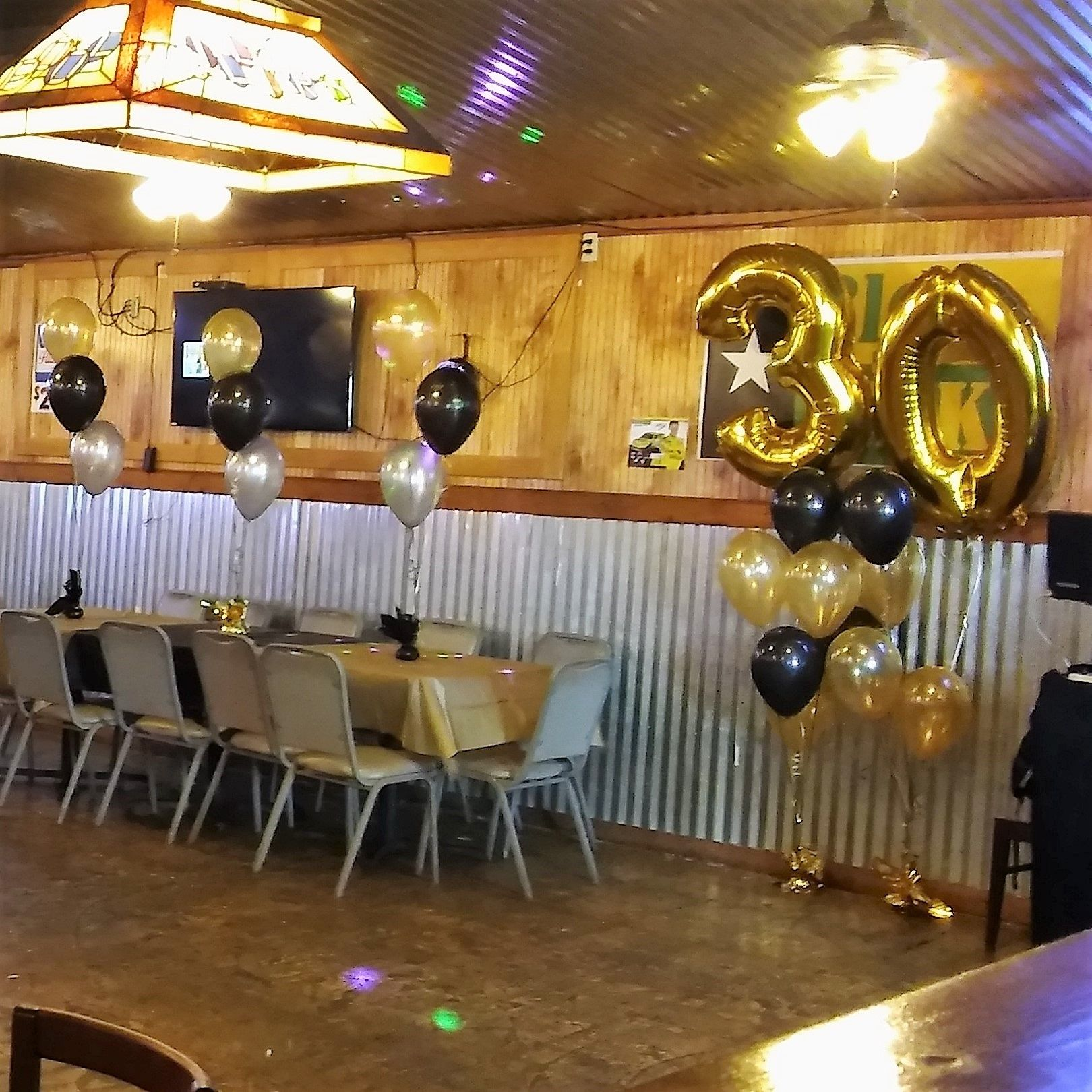 30th birthday party large number Balloon arrangements Black Gold
