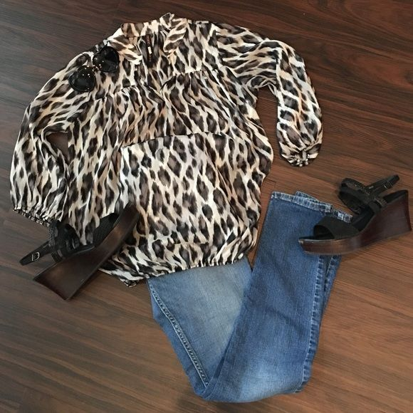 Black, Gray & Sheer Cream Cheetah Blouse This light-weight sheer blouse is gathered with elastic at the waist & arms. Pair with a blank cami. Perfect for summer play or work. Renee Tops Blouses