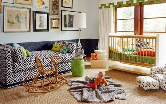 Bold dual guest room and nursery space with modern geometric prints in navy and grass green by Jennifer Delonge.