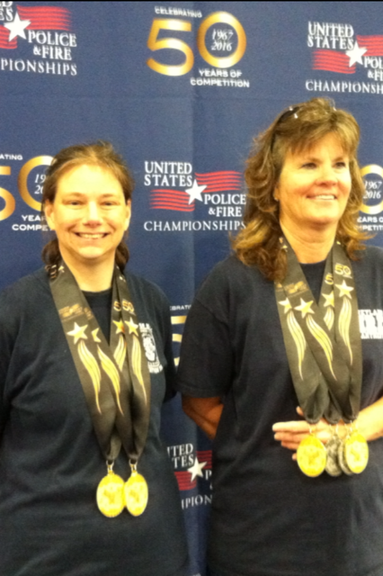 photo of Captain Penny Ingles and fellow competitor with medals