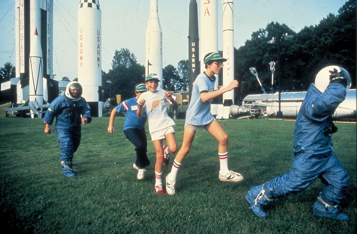 Space suits and activities out in rocket park.