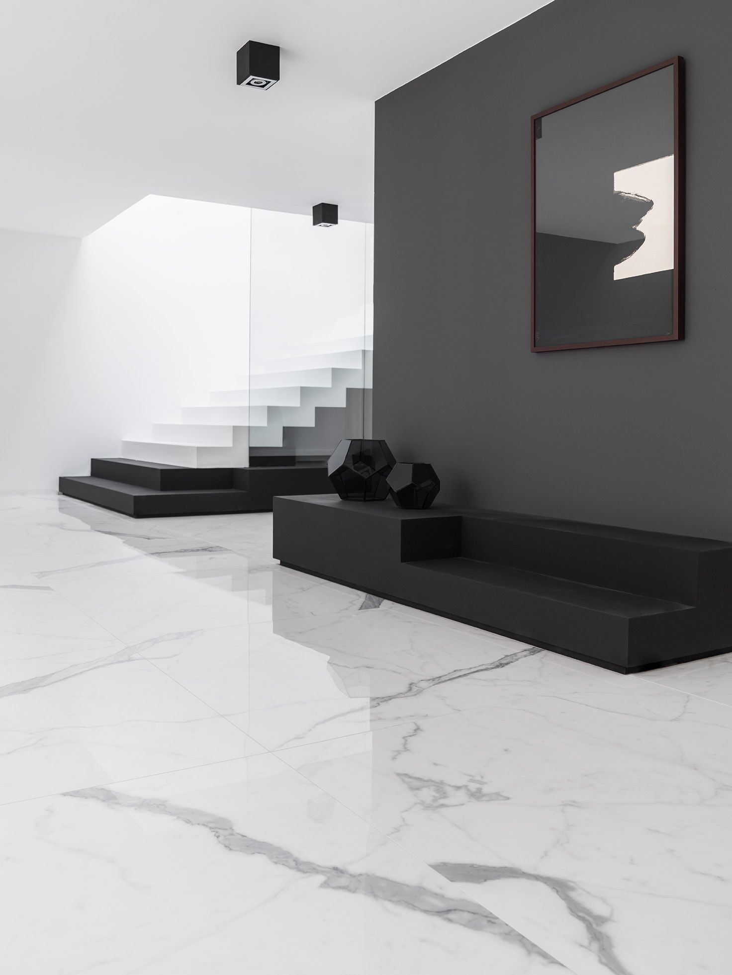 The Marble Floor Contrasts Nicely Against The Solid Black Wall While